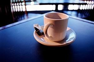 Cup with tea bag on saucer