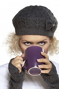 curly haired girl drinking tea