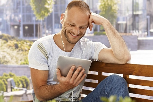 Happy man with e-book reader